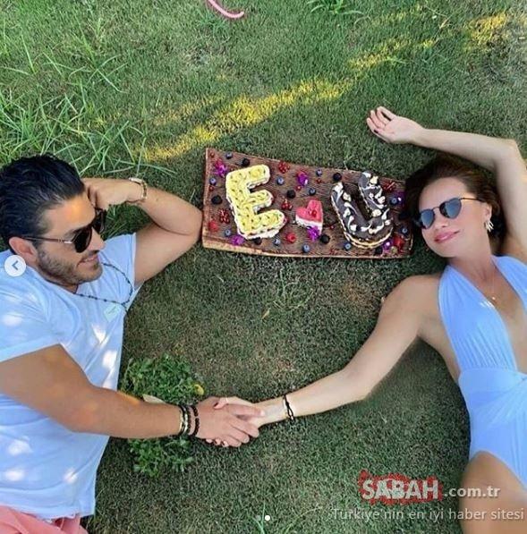 Ebru Şallı ile eşi Uğur Akkuş'un mavi yolculukta romantik anları... Ebru Şallı eşini öpücüklere boğdu!