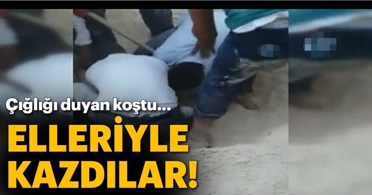 Şanlıurfa'da kum yığını altında kalan çocuğu elleriyle kurtardılar!