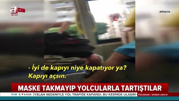 Halk otobüsü içerisinde maskesini yere atıp yolcularla tartıştılar! | Video