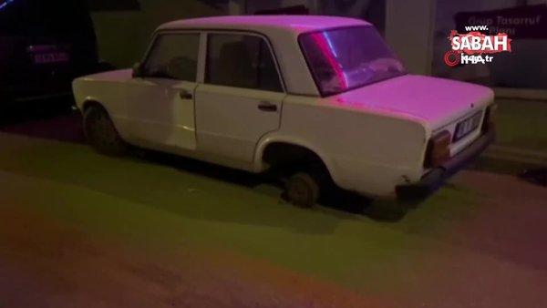 Bursa'da pes dedirten hırsızlık. Park halindeki aracın lastiğini söküp kendi aracına taktı   Video