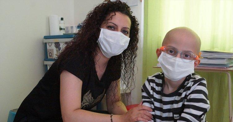 Kanseri yenen Mert Ali yürümeye baslad