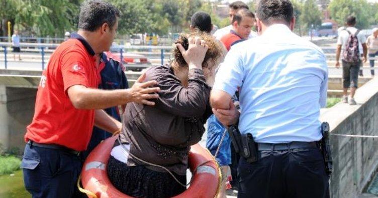 Sulama kanalına atlayan kadını vatandaşlar kurtardı