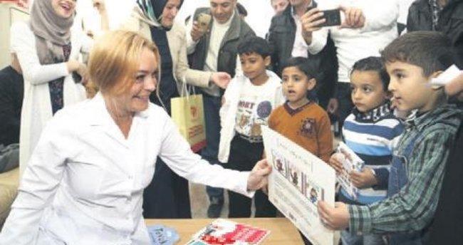 Lohan'dan mülteci çocuklara kitap