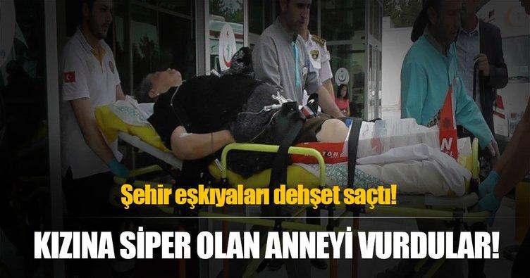 Kızını korumaya çalışan yaşlı kadını bacağından vurdular