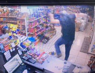 Konya'da marketten yapılan keserli soygun anları güvenlik kameralarına yansıdı