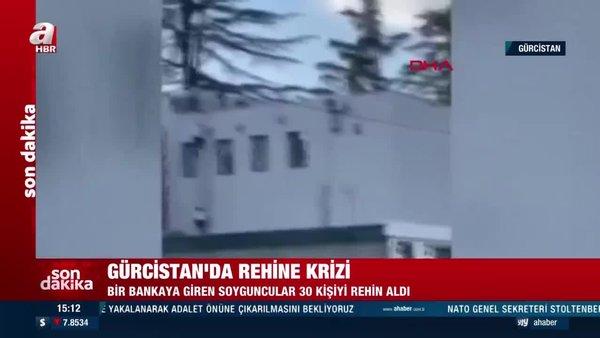 Son dakika... Gürcistan'da silahlı soyguncular bankada 30 kişiyi rehin aldı! İşte ilk görüntüler | Video