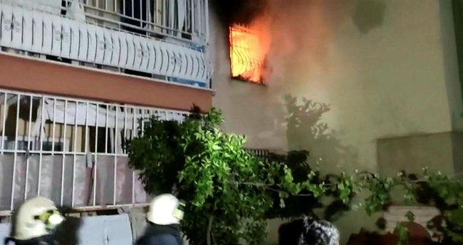 Yangından komşusu kurtardı