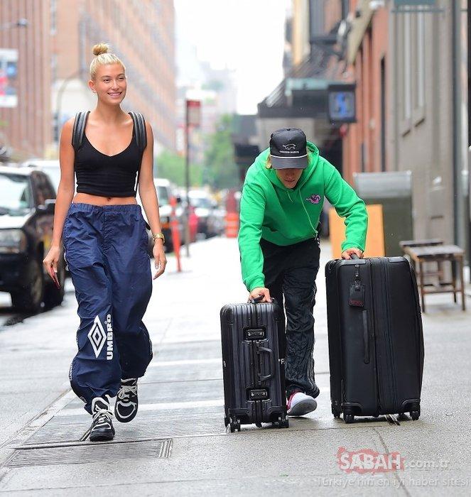 Ünlü model sevgilisine bavullarını taşıttı!