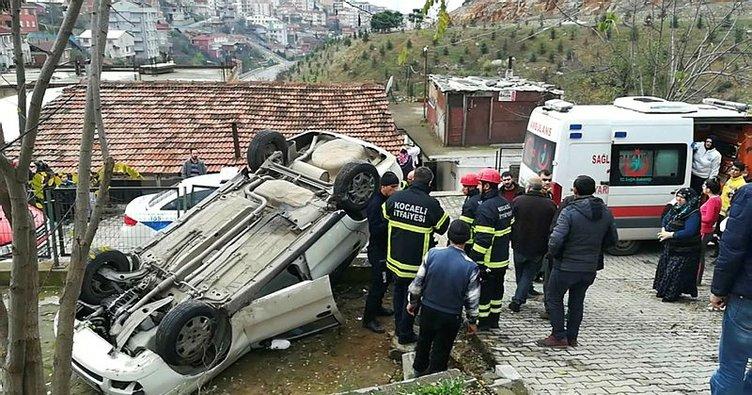 Hızını alamayan otomobil evin bahçesine uçtuKazada araç içinde sıkışan sürücü yaralandı