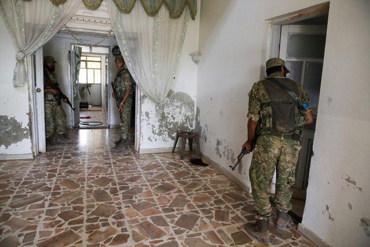Özgür Suriye Ordusu DAEŞ'in boşalttığı evlerde arama yapıyor