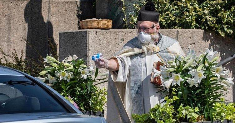 Papaz cemaati su tabancasıyla kutsadı