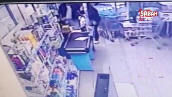 Pişkin hırsız market çalışanın elini ısırdı | Video