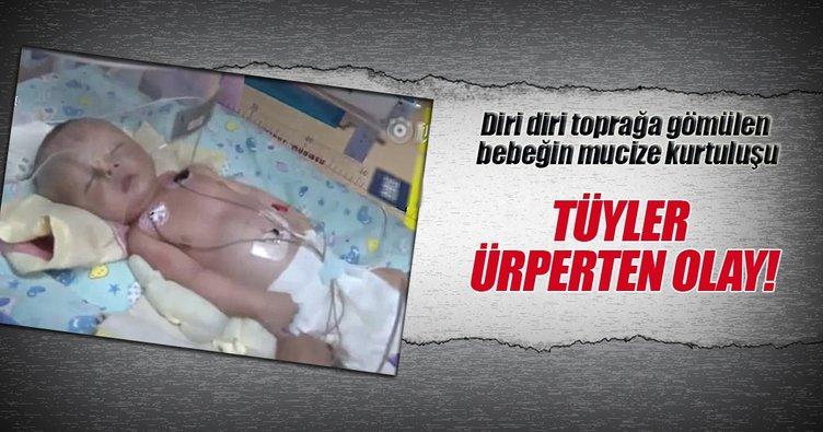 Canlı gömülen bebeği kurtardı