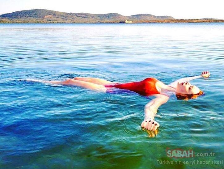 Oyuncu Ayçin İnci kırmızı mayosu ile nefes kesti! Ayçin İnci Çocukken bana su kurbağası derlerdi şimdi deniz kızı...