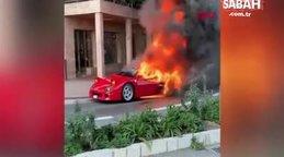 Alev alan Ferrari'yi bahçe hortumuyla söndürmeye çalıştı | Video