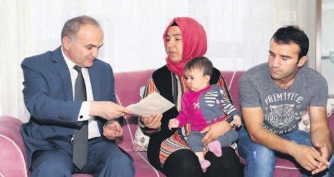 Bakan Özlü'den 'darbe' şehidinin ailesine ziyaret