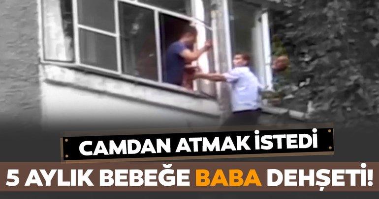 Bebeğini pencereden atmak isteyen babayı polis engelledi
