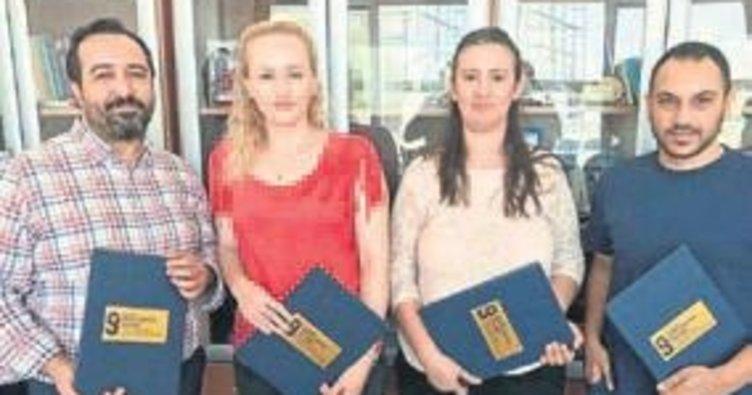 Öğretim üyelerine belgeleri verildi
