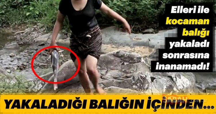 Elleri ile yakaladığı kocaman balığın içinden bakın ne çıktı!
