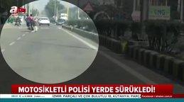 Motosikletli, polisi yerde sürükledi!