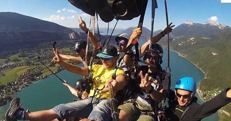 Bir paraşütle 7 kişi atladı