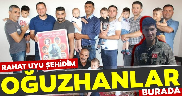 Şehidin ailesi, şehidin adını taşıyan bebekler ve aileleriyle bir arada