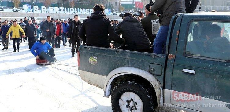 Erzurum'da karda lastik raftingi keyfi. İlk denemeyi Vali yaptı