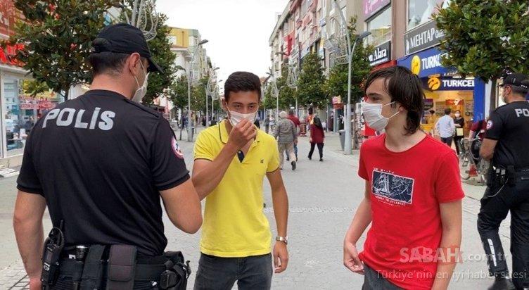 Yüzünde olması gereken maskeyi elinde taşıdığı yetmedi polise tepki gösterdi