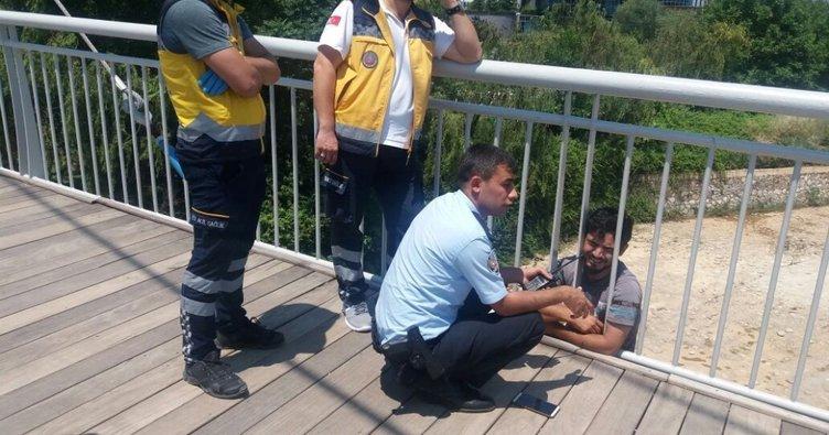 Polis intiharcıyı köprünün demirlerine kelepçeledi