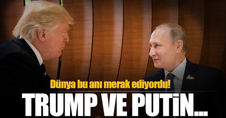 Putin ve Trump el sıkıştı