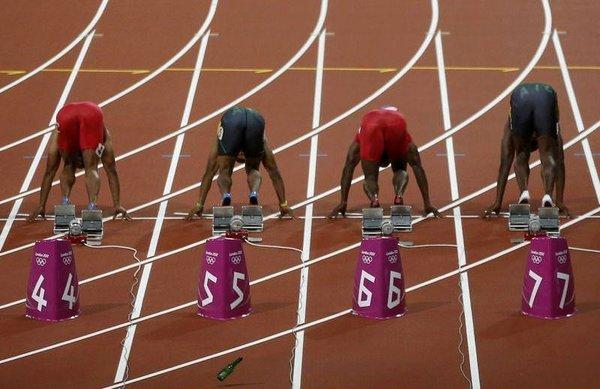 100 metre finalinde piste şişe attı